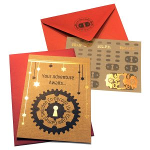 Physical gift vouchers with gold foil printing on kraft paper