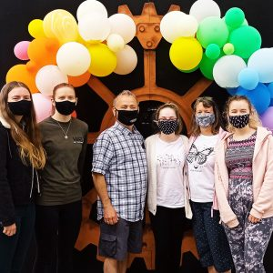 One of our Covid-19 safety measures, a team of 6 people with masks on