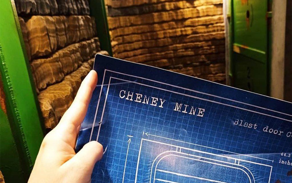Swindon Escape Room - someone holding a blueprint inside a mine